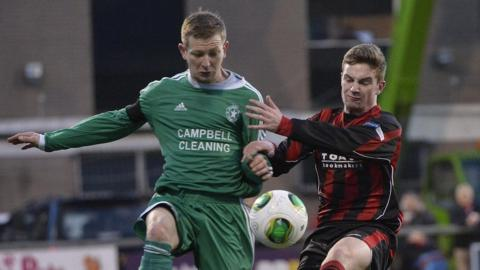 Paul McLarnon and David McAllister vie for possession during the fifth round tie between Crusaders and Crumlin Star