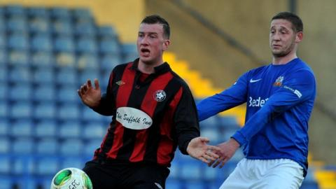Darren Gallagher and Kris Lindsay contend for the ball as Glenavon put seven goals past Sport and Leisure Swifts