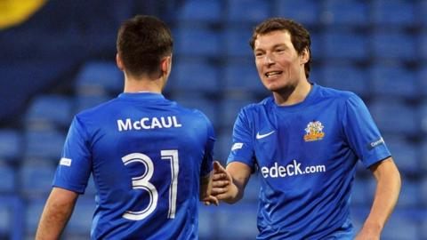 New Glenavon signing Brian McCaul congratulates Kyle Neill who scored the last of his side's seven goals against Sport and Leisure Swifts