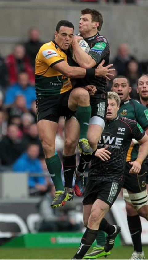 Ospreys fly-half Dan Bigger beats Northampton scrum-half Kahn Fotuali'i to this high ball in the Heineken Cup in Swansea