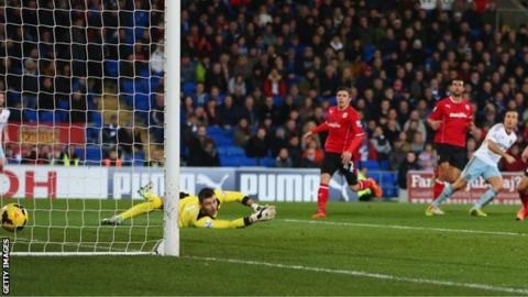 Cardiff keeper David Marshall is helpless to prevent Mark Noble from adding a second, decisive West Ham goal