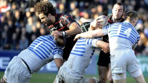 Toulouse scrum-half Jean-Marc Doussain is tackled by Saracens wing Chris Ashton, among others