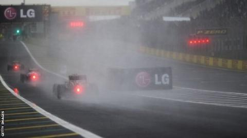 Cars approach a corner at the Brazil Grand Prix