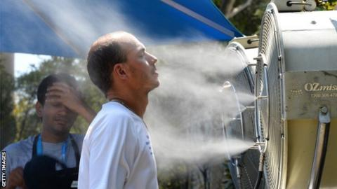 A tennis fan cools off in extreme heat at the Australian Open