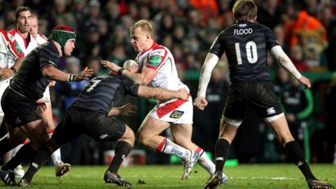 Luke Marshall is tackled by Julian Salvi during the Heineken Cup Pool 5 match at Welford Roa