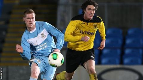 Ballymena's Darren Boyce in action against Dan McMurray of H&W Welders