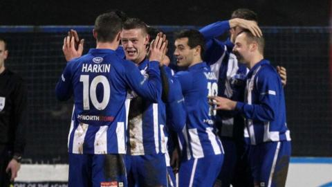 Coleraine players celebrate victory over Cliftonville in the Irish Cup