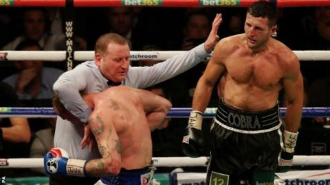 Referee Howard Foster stops Carl Froch (right) and George Groves in their WBA and IBF Super Middleweight title fight against George Groves