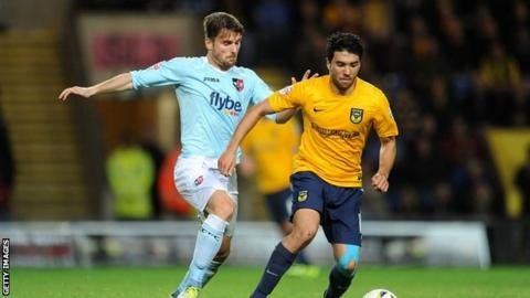 Oxford's Danny Rose and Exeter's Arron Davies