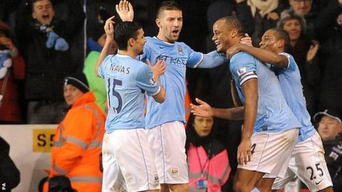 Manchester City celebrate at White Hart Lane