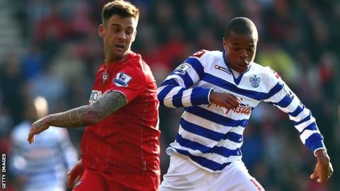Southampton's Danny Fox in action against then QPR striker Loic Remy in march 2013