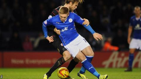 Leicester City's Martyn Waghorn and Reading's Kaspars Gorkss (behind) battle for the ball