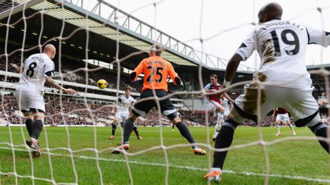 West Ham captain Kevin Nolan heads his second goal against Swansea in his team's 2-0 win at Upton Park