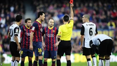 Referee shows a red card to FC Barcelona's Jordi Alba
