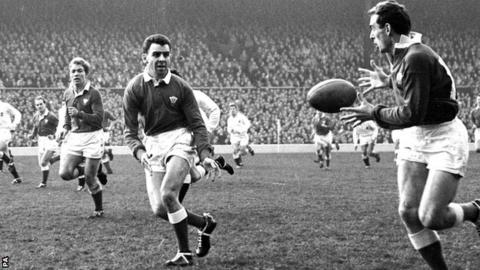 Keith Bradshaw (right) passes the ball to Dewi Bebb during an international against England