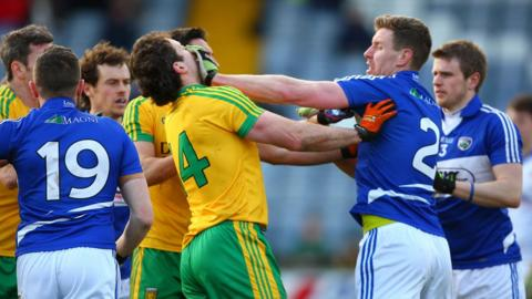 Donegal captain Michael Murphy clashes with Laois player Denis Booth who was sent-off at Portlaoise