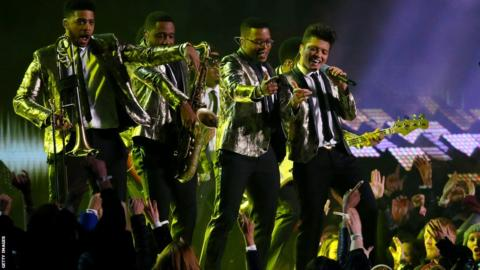 Bruno Mars (far right) kicks off the Super Bowl half-time show