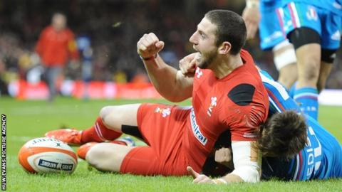 Alex Cuthbert celebrates scoring a try against Italy for Wales
