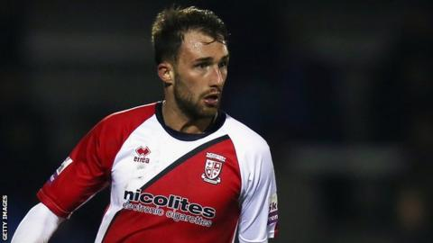 Woking midfielder Josh Payne