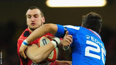 Sam Warburton is tackled while playing for Wales against Italy