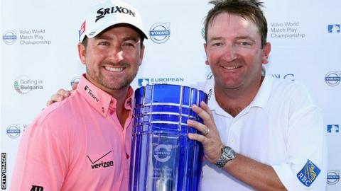 Graeme McDowell and caddie Ken Comboy with the Volvo World Matchplay Championship trophy