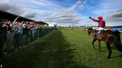 Jockey Barry Geraghty and Sprinter Sacre after winning at Punchestown in April