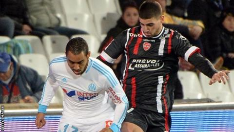 Carl Medjani (right) in action for Valenciennes