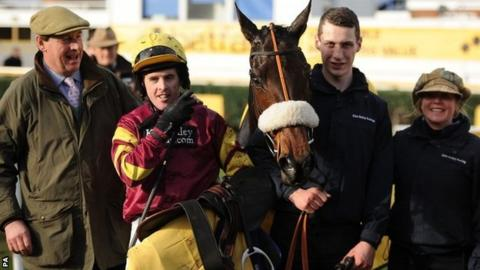 Jockey Jason Maguire (second left) poses with winning connections and trainer Kim Bailey (left) after winning the Denman Chase with Harry Topper (centre)