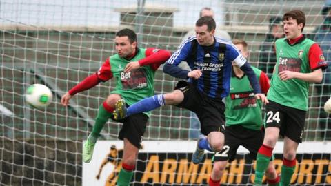 Match action from Ards against Glentoran in the Irish Cup