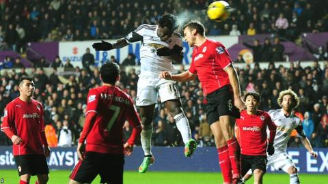 Wilfried Bony rises above Ben Turner to cap a 3-0 victory for Swansea over Cardiff