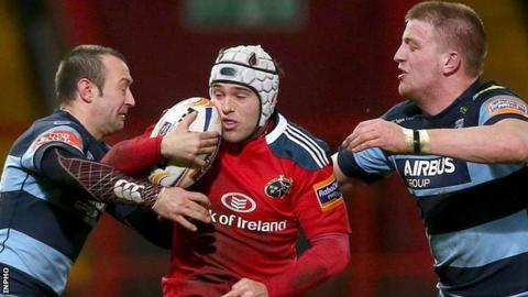 Munster's Duncan Williams is closed down by Gareth Davies and Macauley Cook of Cardiff