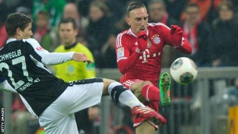 Franck Ribery (right) of bayern Munich challenges Pirmin Schwegler of Frankfurt