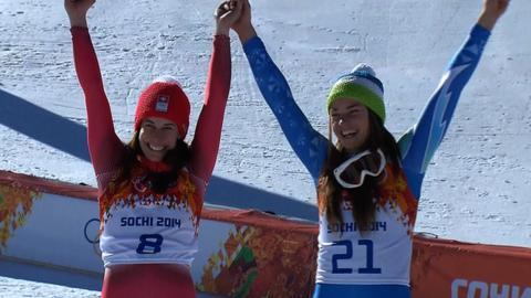 Downhill skiiers Dominique Gisin and Tina Maze (right)