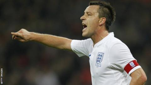 England's Captain John Terry gesturesduring the friendly football match between England and Sweden at the Wembley Stadium in London, on November 15, 2011