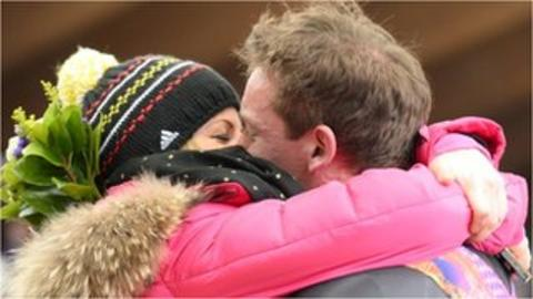 Germany's Felix Loch kisses his girlfriend, Lisa Ressle