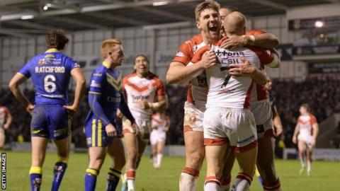 Luke Walsh of St Helens is congratulated on his try by team-mate Tommy Makinson