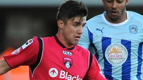 New Coventry City loan signing Michael Petrasso (l) plays against the Sky Blues, on loan from Oldham Athletic, earlier this season.