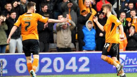 Wolves' Michael Jacobs (right) celebrates with James Henry