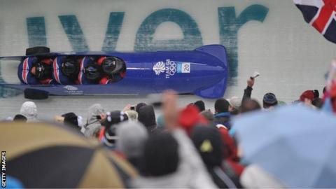 The Britain-1 four-man bobsleigh team piloted by John Jackson during heat 1 at the Whistler sliding centre during the Vancouver Winter Olympics on February 26, 2010.