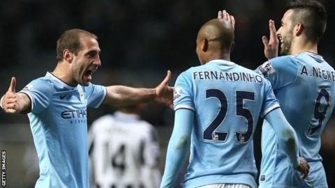 Pablo Zabaleta celebrates with Fernandinho and Alvaro Negredo