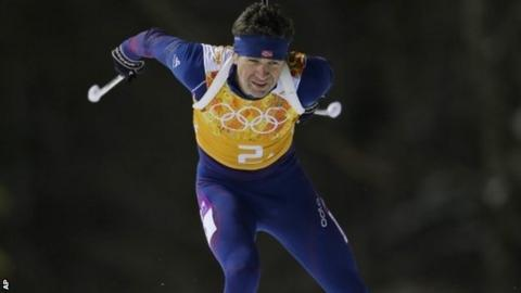 Norway's Ole Einar Bjoerndalen competes as his team win gold during the mixed biathlon relay at the 2014 Winter Olympics