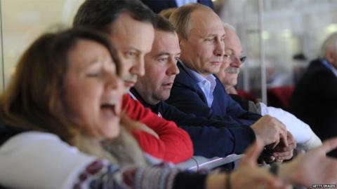 Slovakia's President Ivan Gasparovic, Russia's President Vladimir Putin, Prime Minister Dmitry Medvedev, Deputy Prime Minister Arkady Dvorkovich and Medvedev's press secretary Natalya Timakova watch the Men's Ice Hockey Group A match between Russia and Slovakia at the Bolshoy Ice Dome in Sochi during the Sochi Winter Olympics on February 16, 2014.