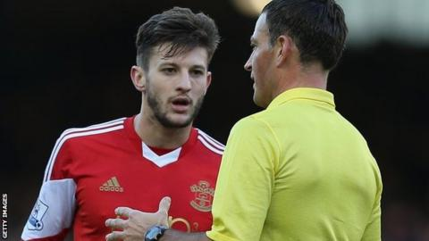 Referee Mark Clattenburg talks to Southampton's Adama Lallana during Everton's 2-1 win over the Saints