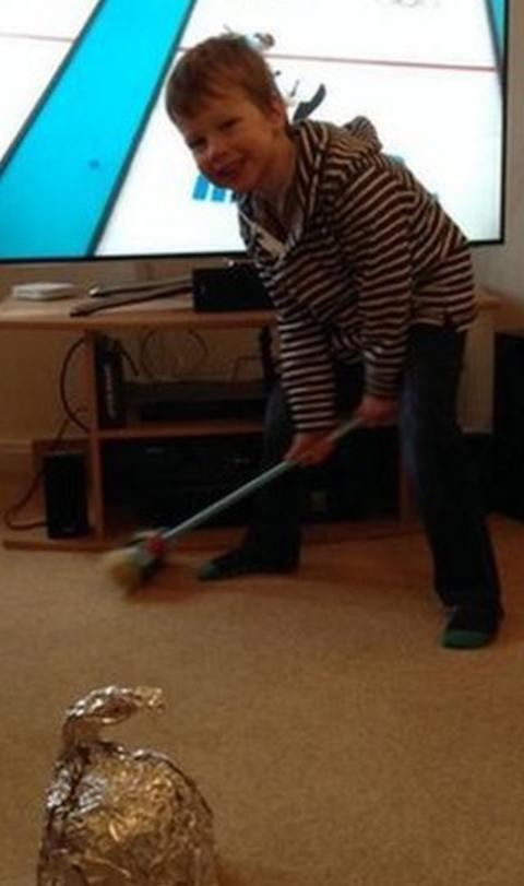 Rhys plays a spot of curling whilst watching the latest from Sochi