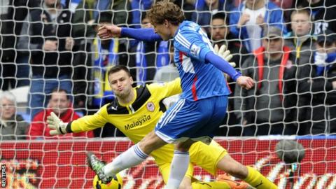Hull's Nikica Jelavic scores past Cardiff goalkeeper David Marshall