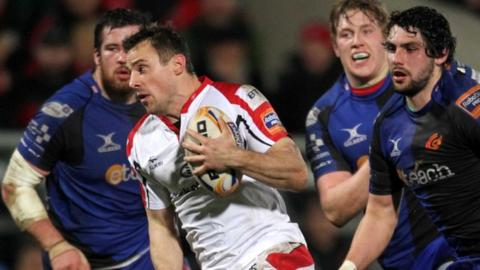 Ulster's Tommy Bowe on his way to scoring a try against Dragons