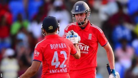 Ravi Bopara and Stuart Broad celebrate England's win v West Indies