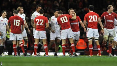 Wales players celebrate after last year's 30-3 victory against England in Cardiff