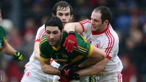 Kerry's Bryan Sheehan is tackled by Ronan McNamee and Ronan McNabb of Tyrone