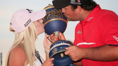Reed celebrates his victory with wife Justine